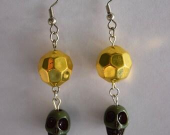 Green skull dangle earrings