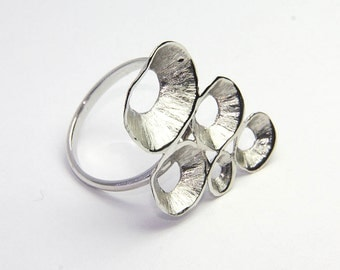 sterling silver ring, big motif featuring abstract shells. fine Greek modern jewelry
