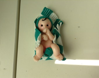 polymer clay baby in a blanket