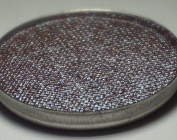 Pavo Pressed Eyeshadow- Deep Maroon base with an intense turquoise duochrome shift