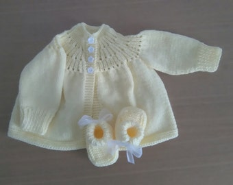 Girls pale yellow 50's style cardigan and classic booties.