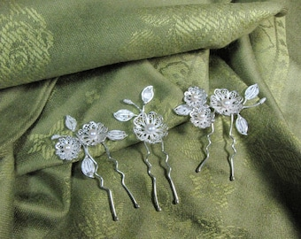 3 fine silver filigree set of floral hair pieces.