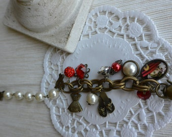 Brass bracelet with charms and beads