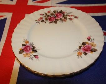 3 tea plates with pink rose design