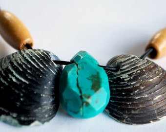 Turquoise necklace with sea shells and wood on black leather