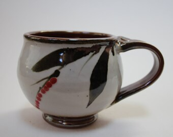 wheel thrown handmade ceramic 12 fl. oz.  mug w/brushwork and red berries porcelain clay pottery