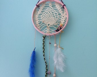 Dream catcher made with antique doily and worry doll