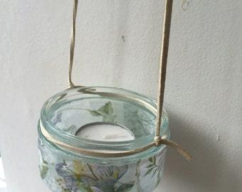 Beautiful hand crafted glass tea light holder.
