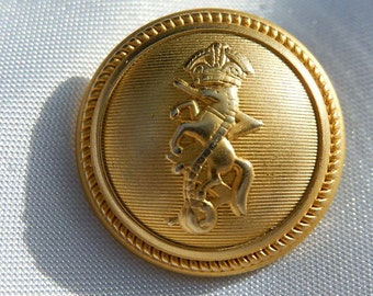 Button with crowned horse.