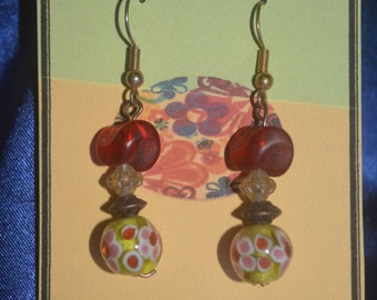Cute lamp work glass earrings.