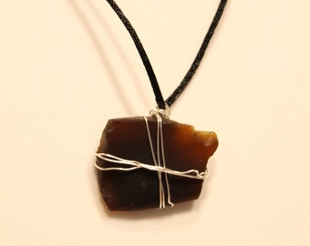 Dark Brown Sea Glass Pendant wit Nylon Overhead Rope. No. 110. About 20 inches long.