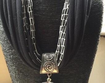 Designer black and white pendant scarf