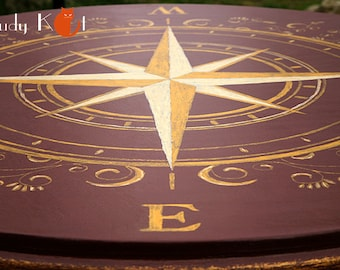Table with gold Compass Rose in the baroque style -maritime