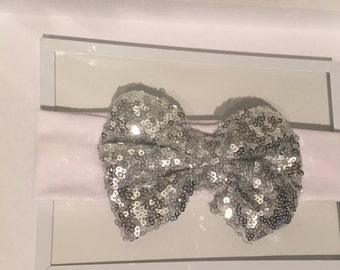 White sequin bow