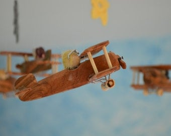 Mobile aircraft wooden with stars in crochet, handmade