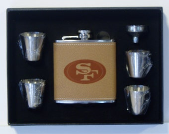 san francisco 49ers engraved leather 6 oz stainless steel flask with 4 stainless steel shot glasses and a funnel in a black presentation box box san francisco office 6