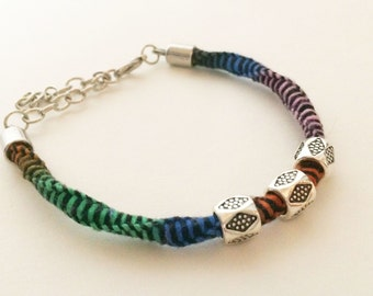 Multicolored spiral macrame bracelet with metal beads