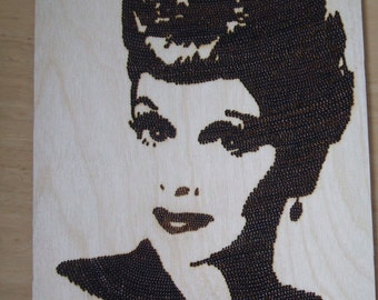 Woodburnt portrait of Lucille Ball