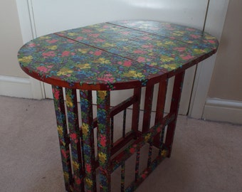 Decoupaged small drop leaf table