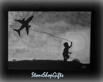 The boy with the aeroplane