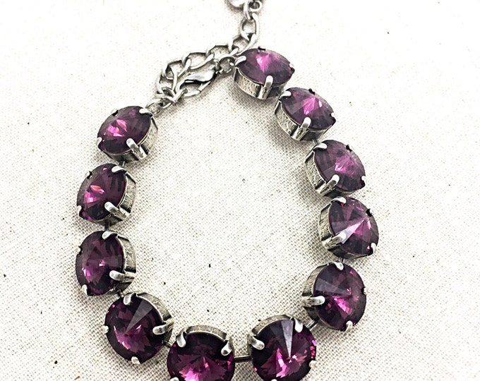 Stunning statement bracelet adorned with colorful purple amethyst Swarovski crystals that provide plenty of eye-catching sparkle.