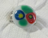 Fused glass ring: fused with red and blue flower on a white background; silver plated stretch ring; millefiore
