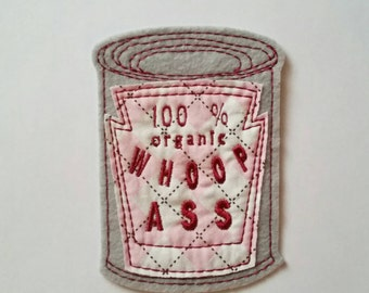 Iron on Patch Can of 100% organic Whoop *ss Embroidered Applique in Pink Argyle and Gray Felt