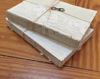 White washed book risers for wedding decor