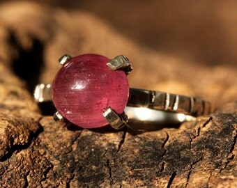 Stunning natural ruby cabochon ring in heavily textured handcrafted silver band