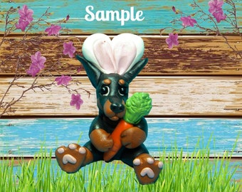 Black and Tan Doberman Pinscher cropped ears Easter Bunny dog with Carrot OOAK Polymer Clay art sculpture by Sallys Bits of Clay
