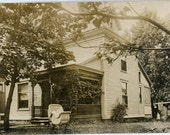 vintage photo Baby in Wicker Buggy Set Alone Outside Large Home RPPC