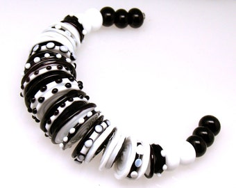 Pearly white and black disc and round  (35) Lampwork beads SRA made to order