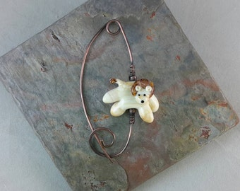 In the jungle...lampwork art glass lion shawl pin.