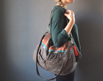 The TUNDRA Leather Bag /// slouchy brown textured leather bag with southwestern fabric and tassel