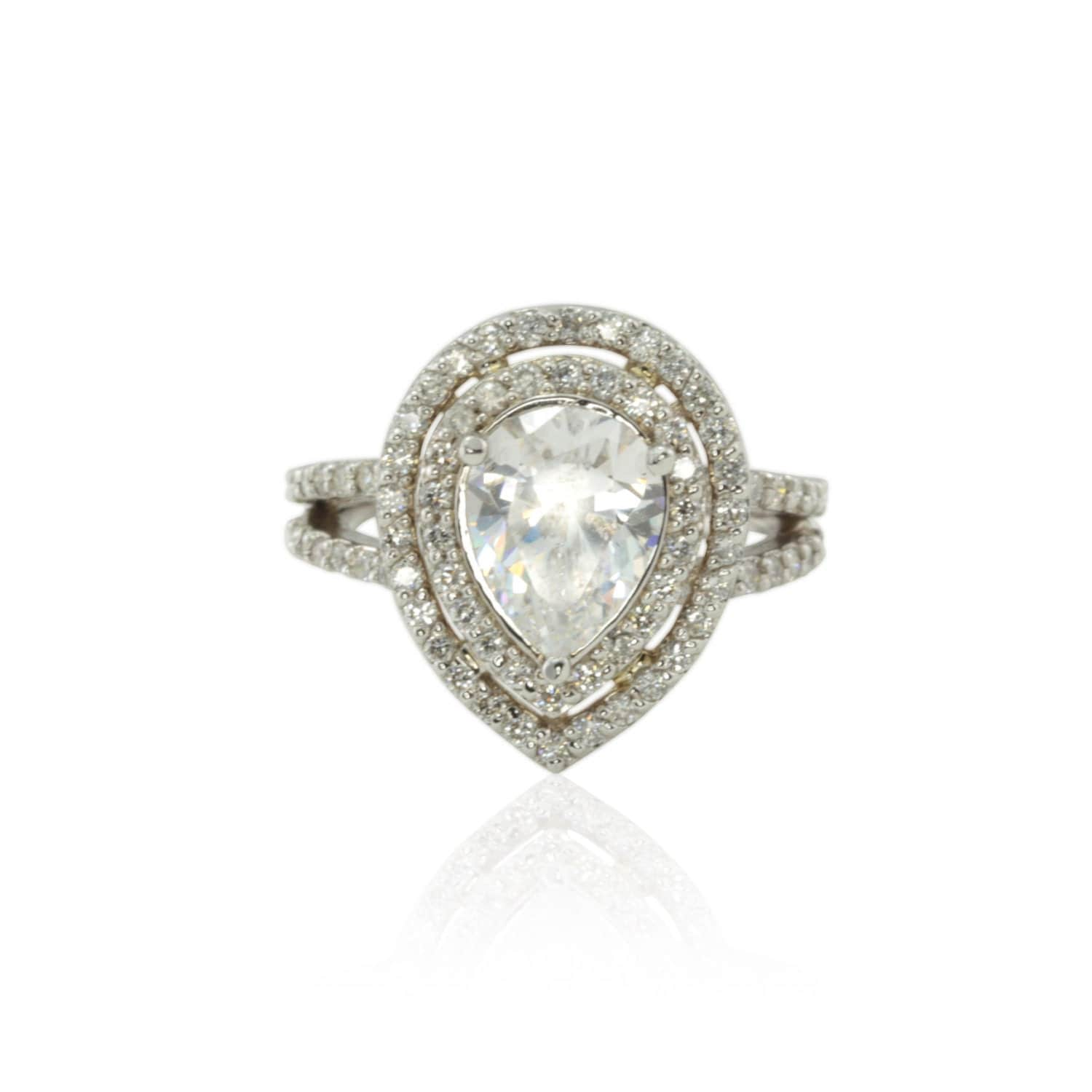cz engagement ring with pear shaped halo and