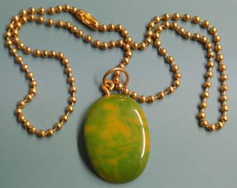 Pendant necklace with genuine tested vintage 1950s swirled yellow/ green tested bakelite plastic bead and brass ball chain