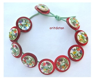 Button bracelet jewelry made of vintage buttons, new shell buttons, leather cord