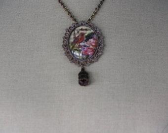 Bird with birdcage necklace breaths spring