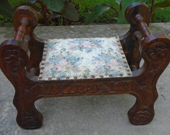 Small ornate art deco vintage wooden footstool ottoman or bench with intracate woodworking pink and blue floral tapestry seat with rivets
