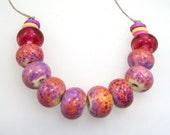 Handmade Lampwork Beads - Poetry in Motion! 10 bead set. Classic purple rose on opal yellow. Veiled Rubino accent beads.