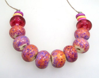 Handmade Lampwork Beads - Poetry in Motion! 10 bead set. Classic purple rose on opal yellow. Veiled Rubino accent beads.