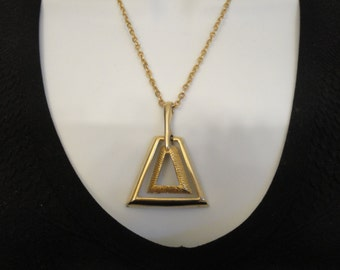 Vintage metal pendant in dual triangular shape on gold tone chain 18 inch long chain, 2  inch pendant, Barrel style clasp