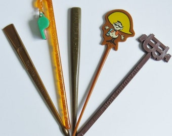 Five novelty swizzle sticks