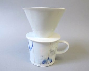 porcelain cup with coffee pour over