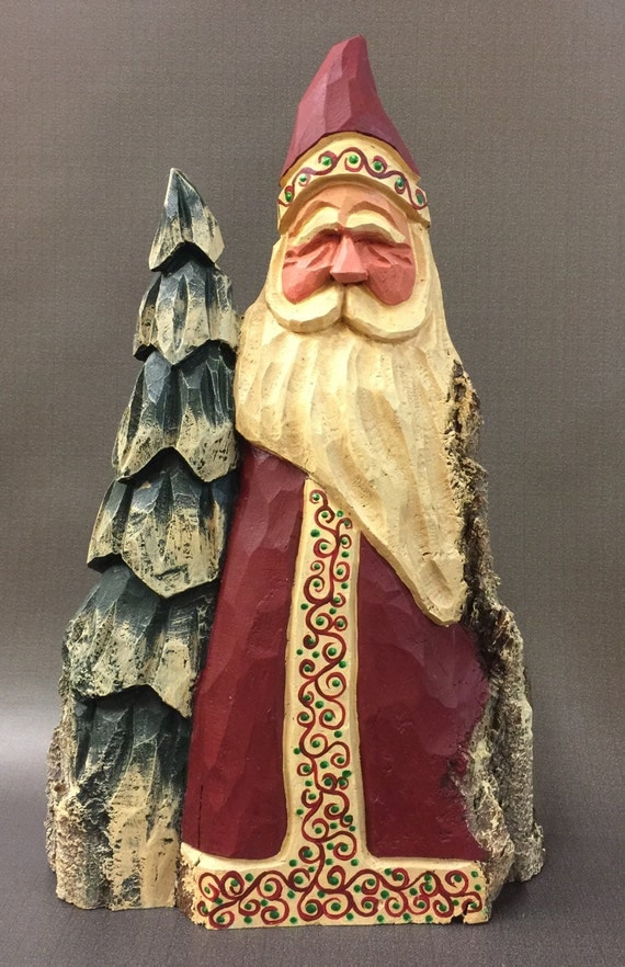 Hand carved original large santa with tree from year old