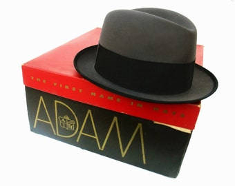 New Vintage 60s Adam Homburg Hat Narrow Brim Charcoal Gray Felt Black Ribbon Band Gold Metal Knight Horse Cavelier Original Box size 6 7/8