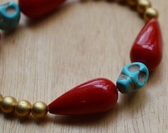 Gold Pearl and Ruby Teardrop Muertos Skull Bracelet