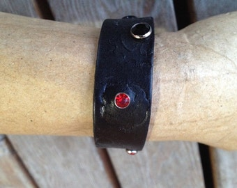 Black leather wristband with rivets and stamps