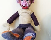 Vintage Monkey Bellhop Organ Grinder with Plastic Head Straw Stuffed Cordouroy Body  About 12 Inches Tall Condition Issues But Cute Display