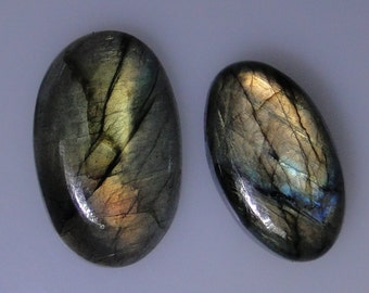 2 Labradorite oval cabs with very good multi color flash, 108.81 carats t.w.            043-10-684
